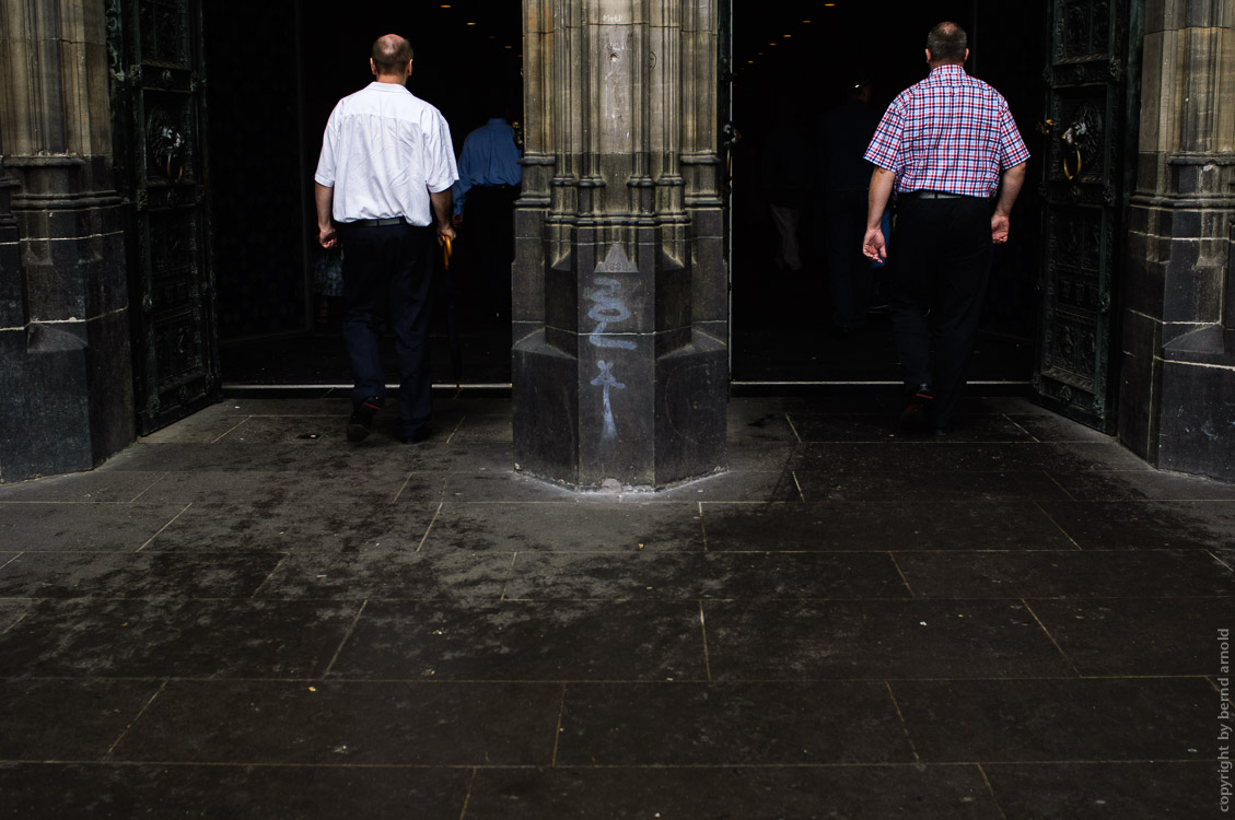two men walked in to the Cologne cathedral at the West Portals - Photography and Portfolio